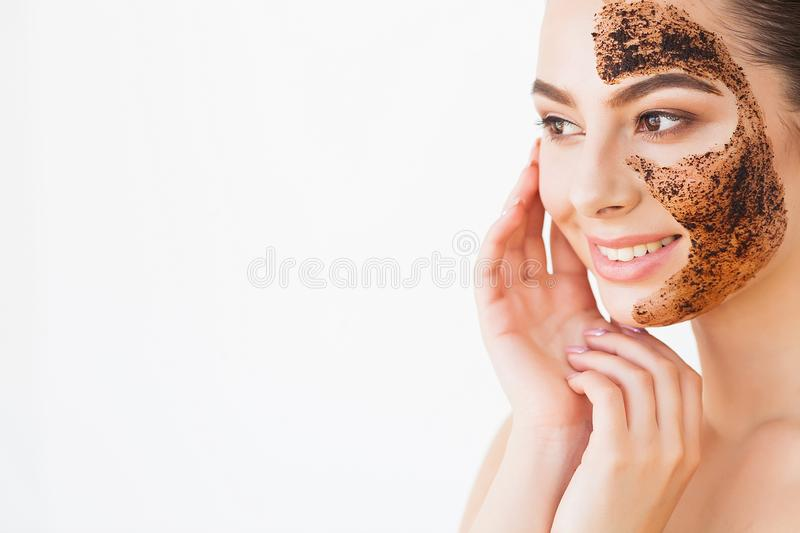 Face Skincare. Young charming girl makes a black charcoal mask o royalty free stock images