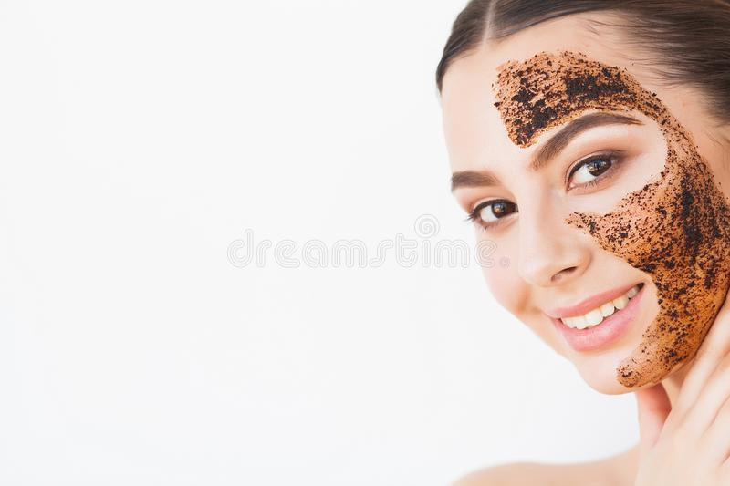 Face Skincare. Young charming girl makes a black charcoal mask o stock images