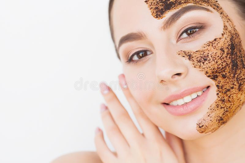 Face Skincare. Young Charming Girl Makes a Black Charcoal Mask on Her Face stock photography