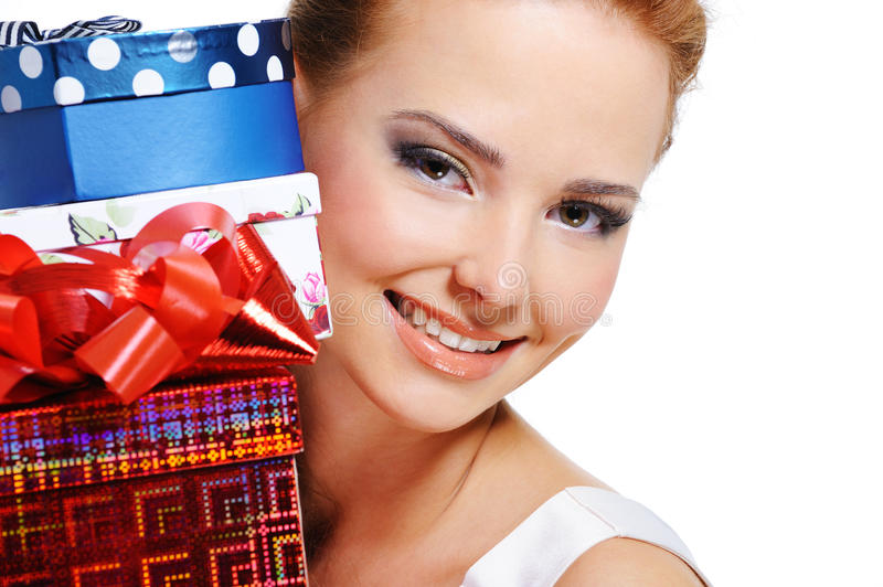 Download Face Of Smiling Girl With The Many Presents Stock Photo - Image: 11335074