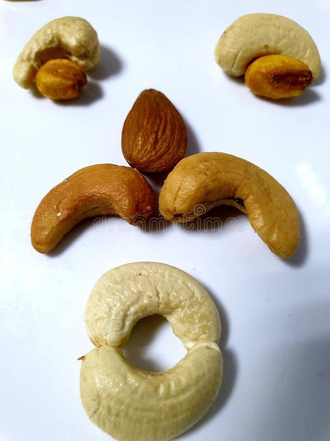 A face by some types of mix nuts. Benefits nuts, healthy nuts, cashews, Almonds, roasted corn royalty free stock image