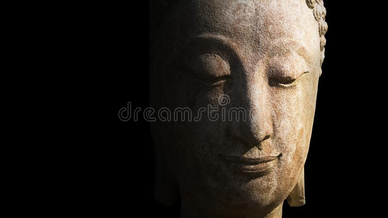 Face of statue Buddha close up in Chiang Mai Province, Thailand. Statue of Buddha made from white stone, old vintage grunge style. light shine on Buddha statue royalty free stock images