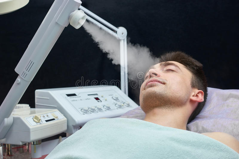 Face steaming, young man. stock images