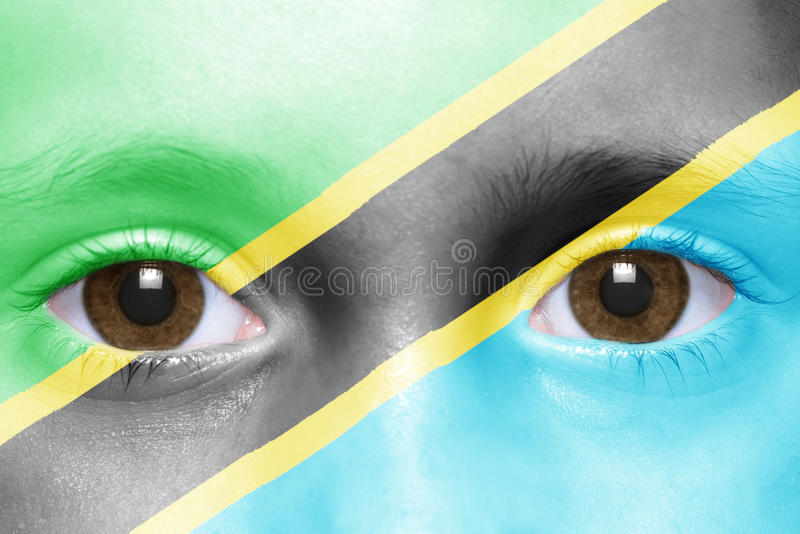 Face with tanzanian flag. Human`s face with tanzanian flag royalty free stock photo