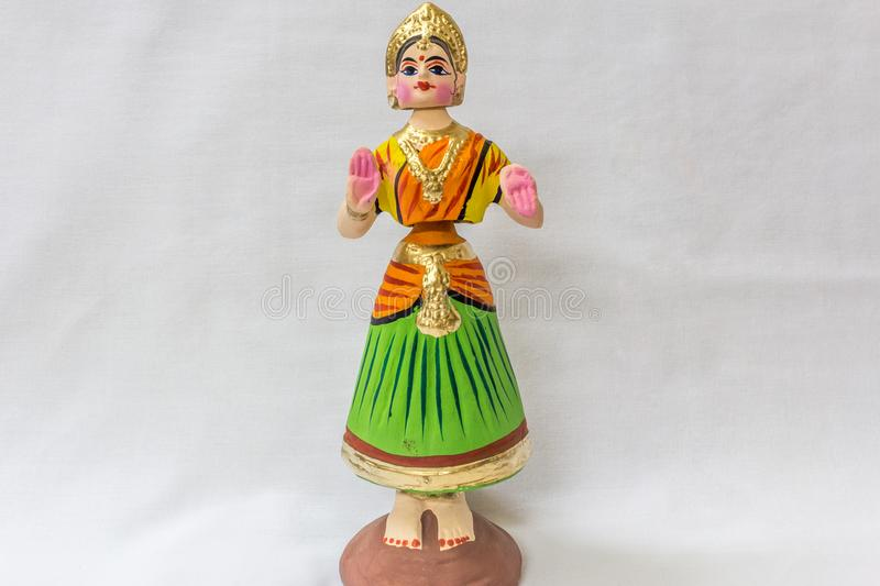 Face of a Thanjavur dancing doll Called as Thalaiyatti Bommai in Tamil language with look alike traditional dress and oranments. In a white background royalty free stock photos