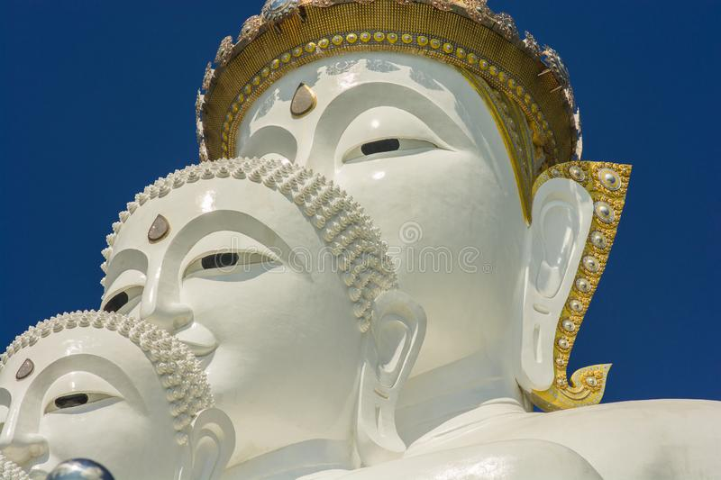 The face of a three-tiered Buddha royalty free stock photo