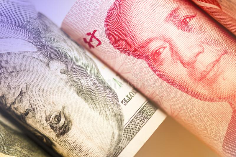 Face to face of Benjamin Franklin and Mao Tse tung from US dollar and China Yuan banknote. It is symbol of economic tariffs trade. War royalty free stock photography