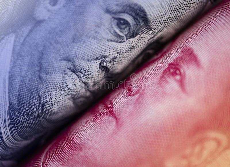 Face to face of Benjamin Franklin and Mao Tse tung from US dollar and China Yuan banknote. It is symbol of economic tariffs trade. War stock photo