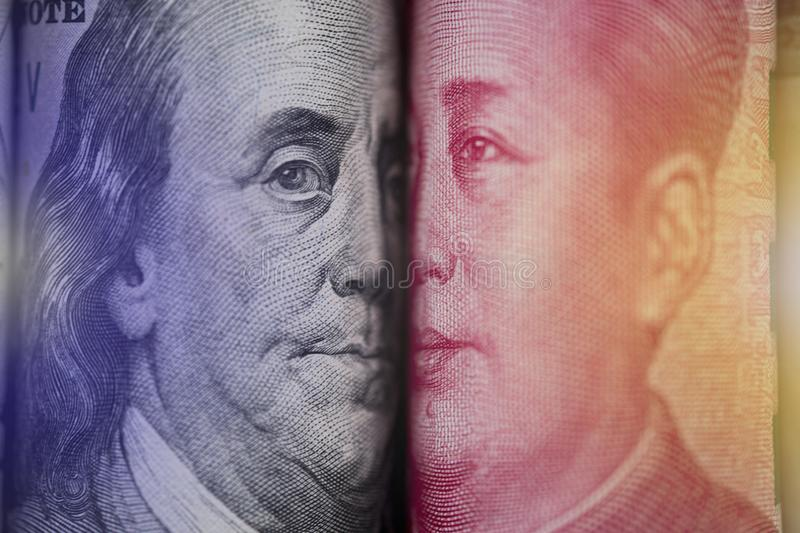 Face to face of Benjamin Franklin and Mao Tse tung from US dollar and China Yuan banknote. It is symbol of economic tariffs trade. War royalty free stock photo