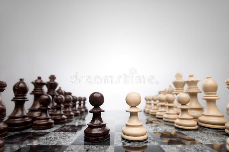 Face to face like wall and axe. First move: two pawns opposition in the middle of the board royalty free stock images