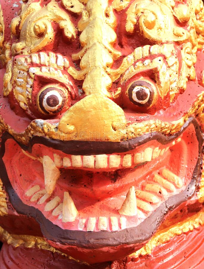 Face of a traditional cambodian lion statue, Cambodia. Face of a traditional cambodian lion statue at temple, Cambodia stock photo