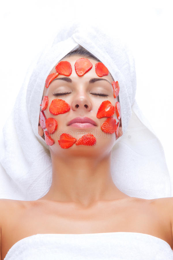 Face treatment. Portrait of young beautiful woman being cosmetic treated stock photo