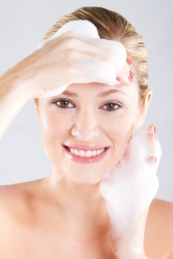 Face wash royalty free stock photos