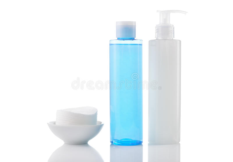 Face wash cleansing gel, toner and cotton cleansing pads isolate. Daily cleansing cosmetics - face wash cleansing gel, smoothing toner and cotton cleansing pads royalty free stock photo
