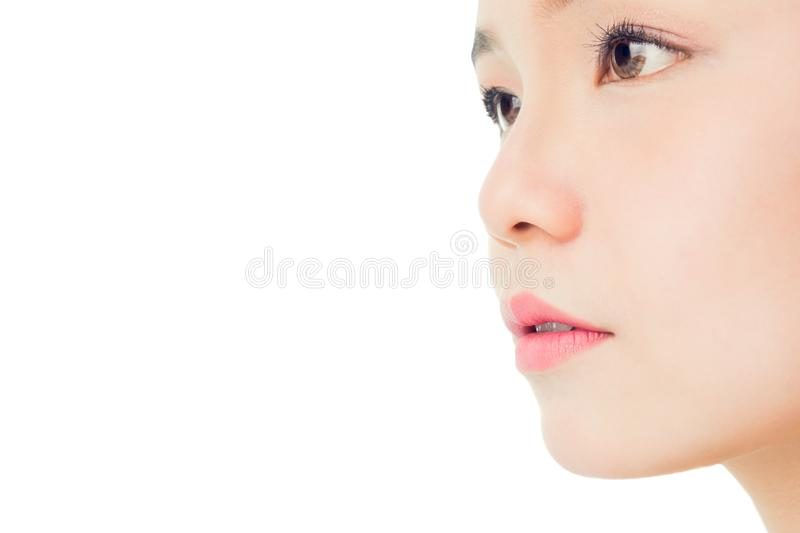 The face of a woman with good skin health and pink lips. Eyes are looking forward. Copy space for use in advertising beauty products royalty free stock photos