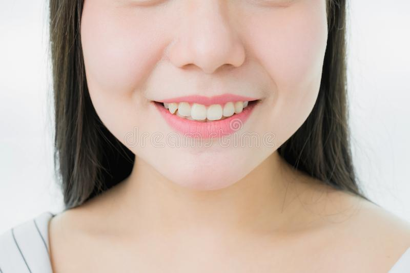 The face of a woman with good skin health are smiling and pink lips, for use in advertising. The face of a woman with good skin health are smiling and pink lips royalty free stock photo
