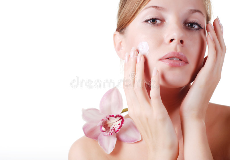 Face of woman and orchid royalty free stock images
