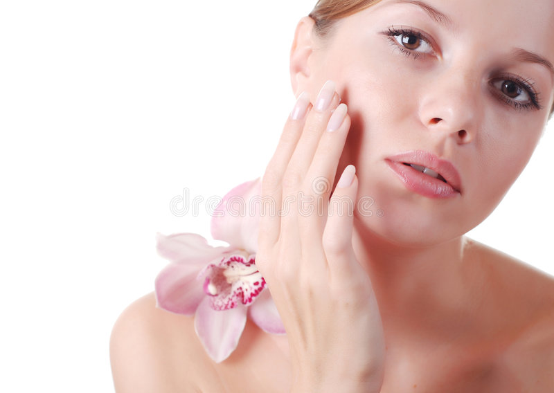 Face of woman and orchid stock image
