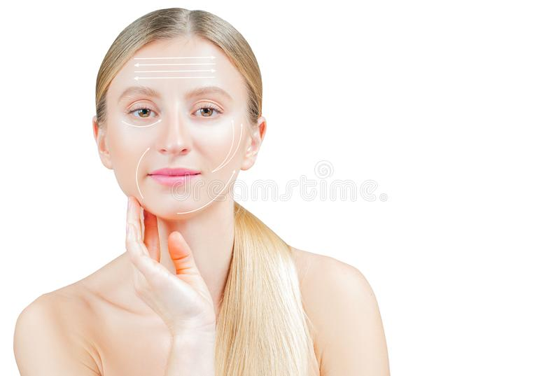Face lift anti-aging treatment. Beautiful woman with perfect skin  with arrows on face royalty free stock photo