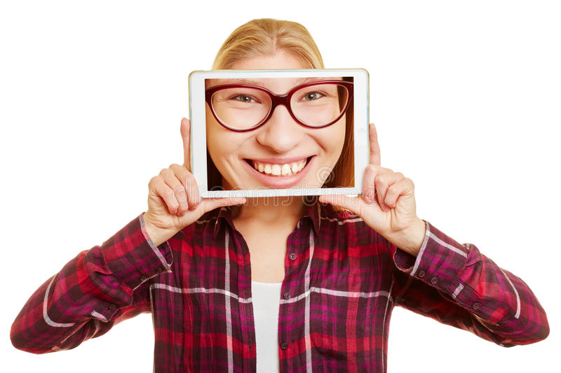 Face of a woman on a tablet stock photography