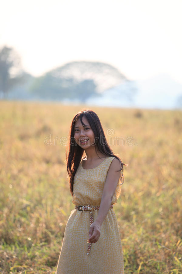 Download Face Of Women Standing In The Grass Field With Ev Stock Photo - Image: 24505540