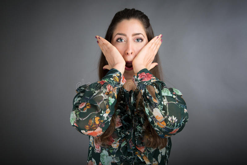 Face Yoga pose. Beautiful brunette woman doing face yoga stock image
