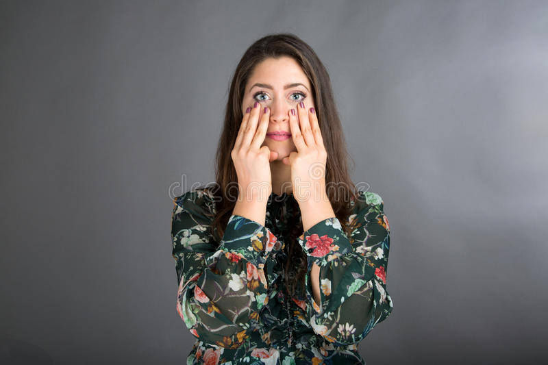 Face Yoga pose. Beautiful brunette woman doing face yoga royalty free stock photography