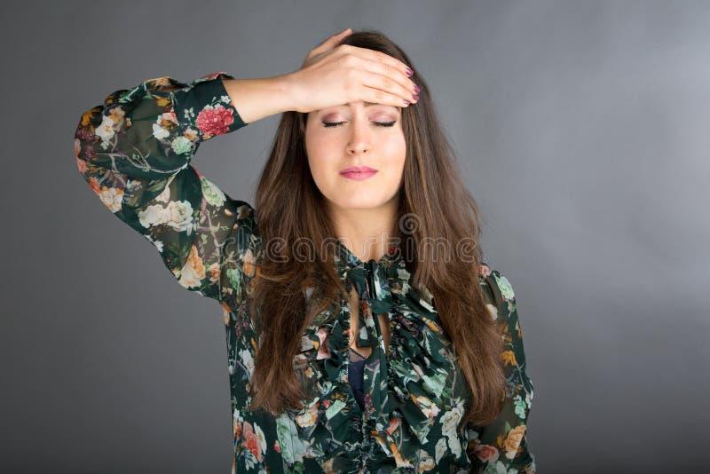 Face Yoga pose. Beautiful brunette woman doing face yoga royalty free stock photos
