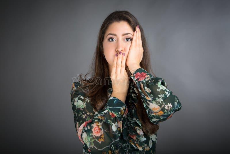 Face Yoga pose. Beautiful brunette woman doing face yoga stock photography