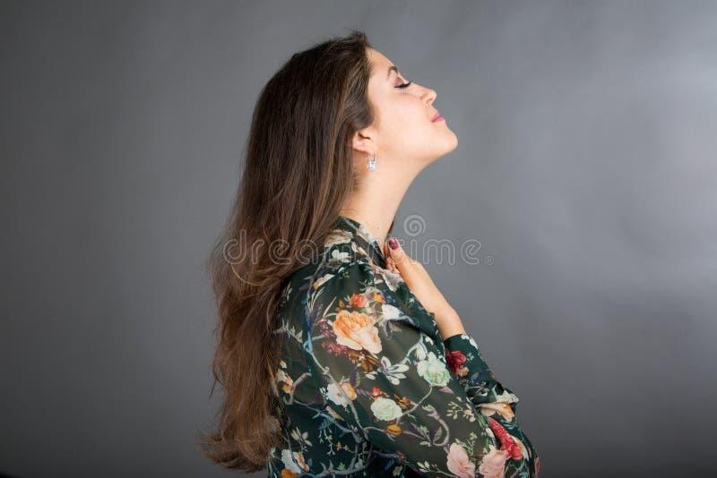 Face Yoga pose. Beautiful brunette woman doing face yoga stock photo