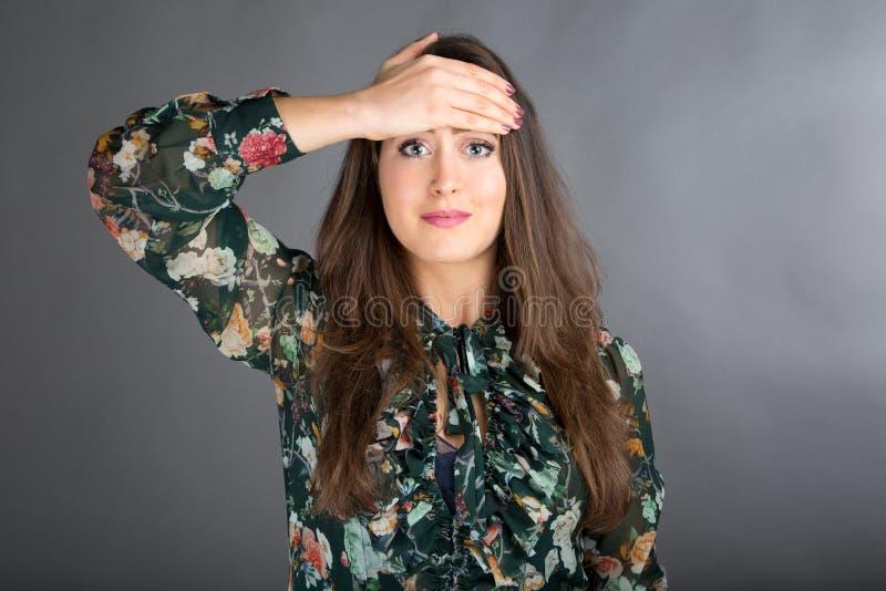 Face Yoga pose. Beautiful brunette woman doing face yoga stock images