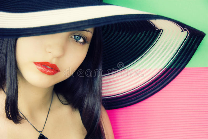 Face of young beautiful brunette in hat. Face of young beautiful brunette in a summer hat stock photo