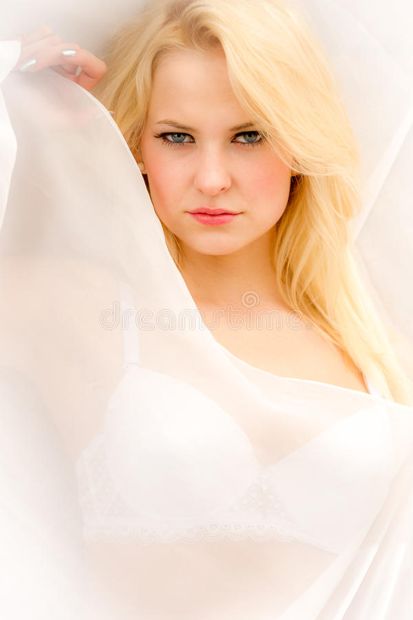 Face of young beautiful woman in bed stock image