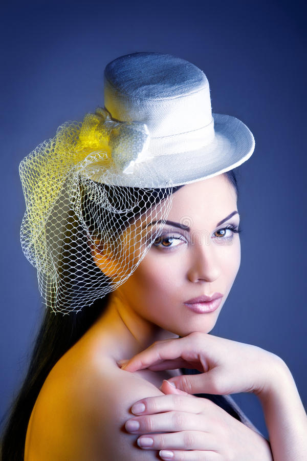 Face of young beautiful woman in a vintage hat royalty free stock images