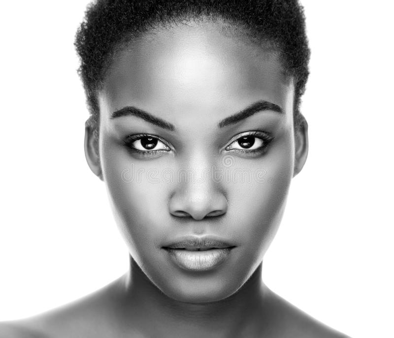 Face of an young black beauty. In black and white stock photo