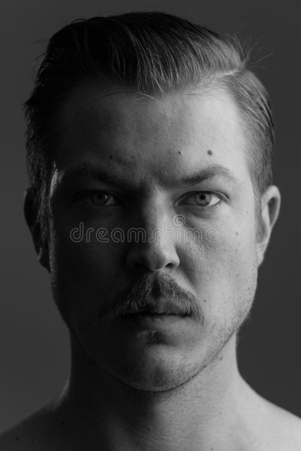 Face of young Caucasian man with mustache shirtless stock photo