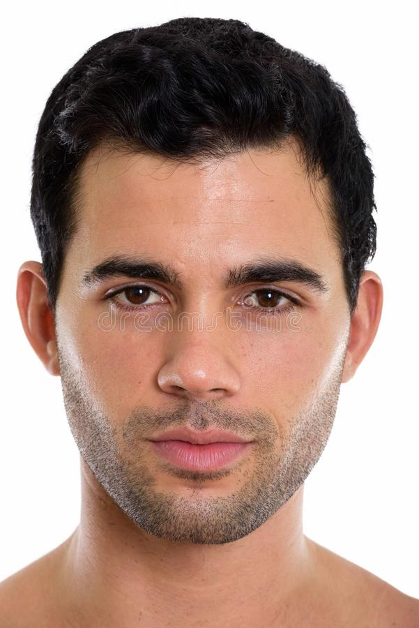Face of shirtless young handsome Hispanic man. Face of young handsome Hispanic man isolated against white background royalty free stock photo