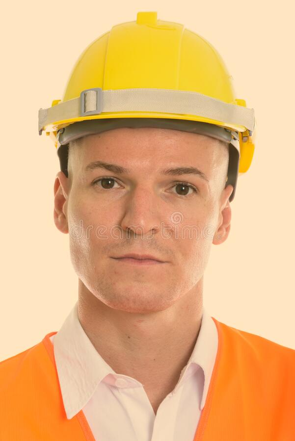 Face of young handsome man construction worker royalty free stock photos