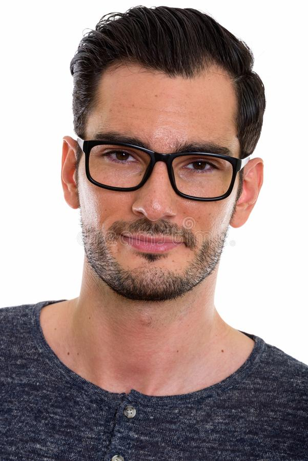 Face of young handsome man wearing eyeglasses royalty free stock image