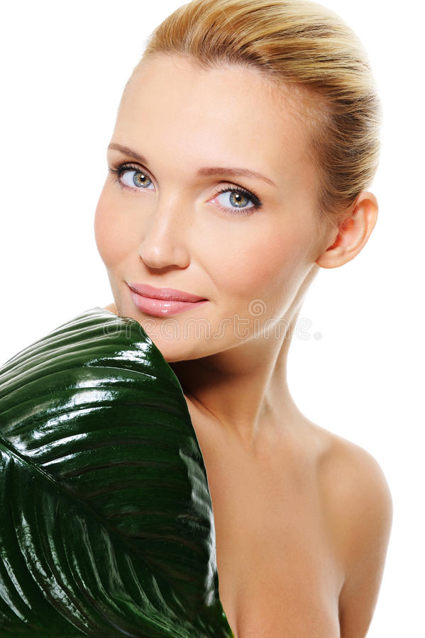 Download Face Of A Young Health Woman With The Green Leaf Stock Photo - Image: 13083732