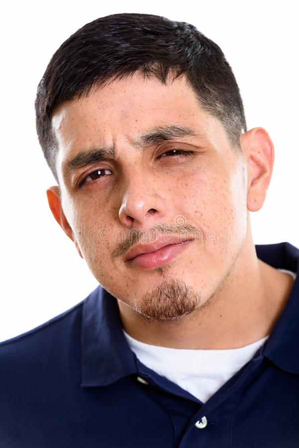Face of young Hispanic man looking confused royalty free stock photos