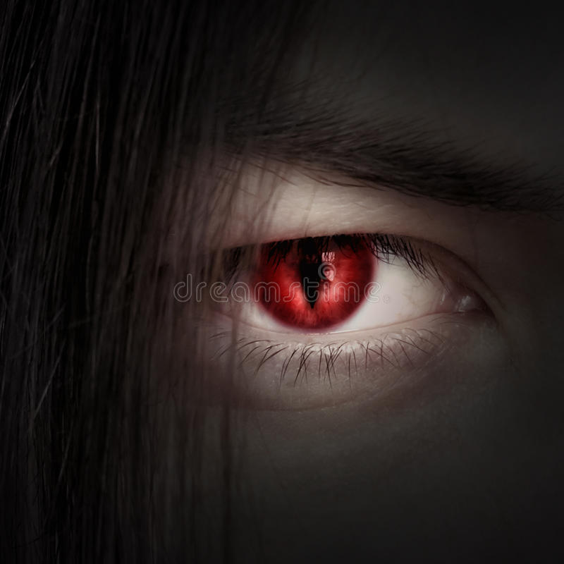 Face of a young male vampire close up royalty free stock image