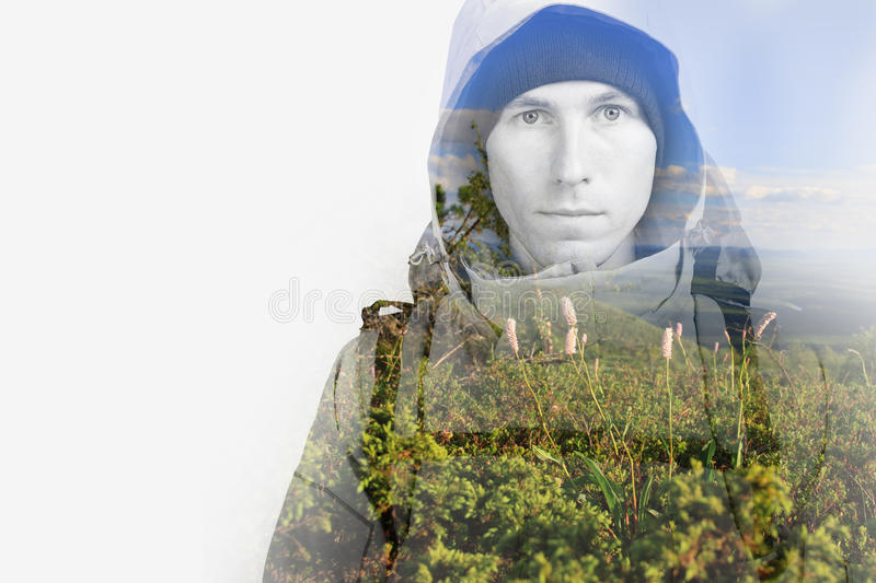 Face of young man hiker and green hills. Double exposure effect photography. Face of young man hiker and green hills. Double exposure effect photography with royalty free stock photos