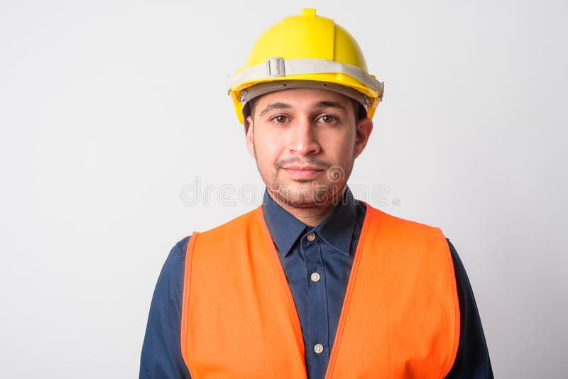 Face of young Persian man construction worker royalty free stock image