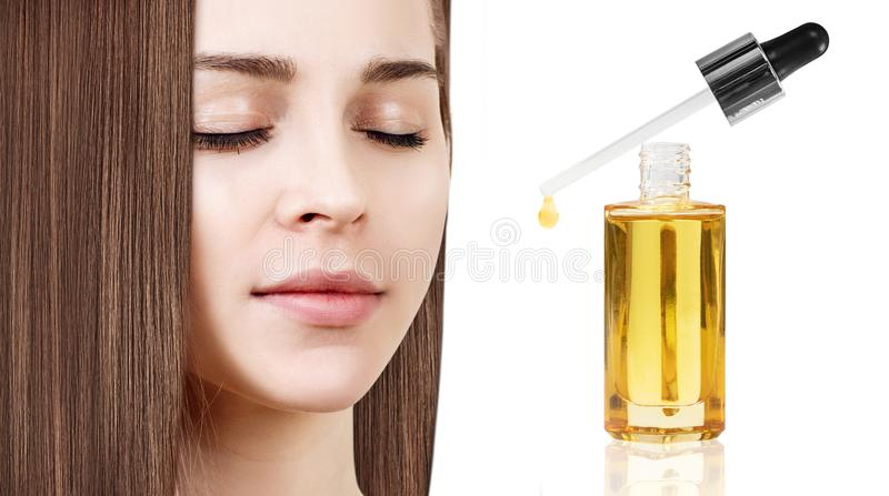 Face of young woman and bottle with cosmetics primer oil. royalty free stock photos