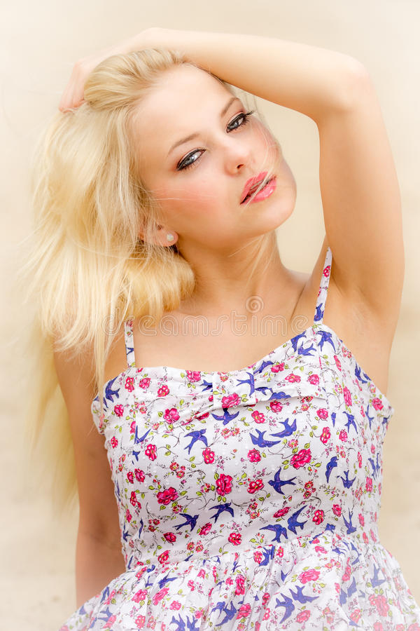 Face of a young woman dressed in a beautiful dress stock image