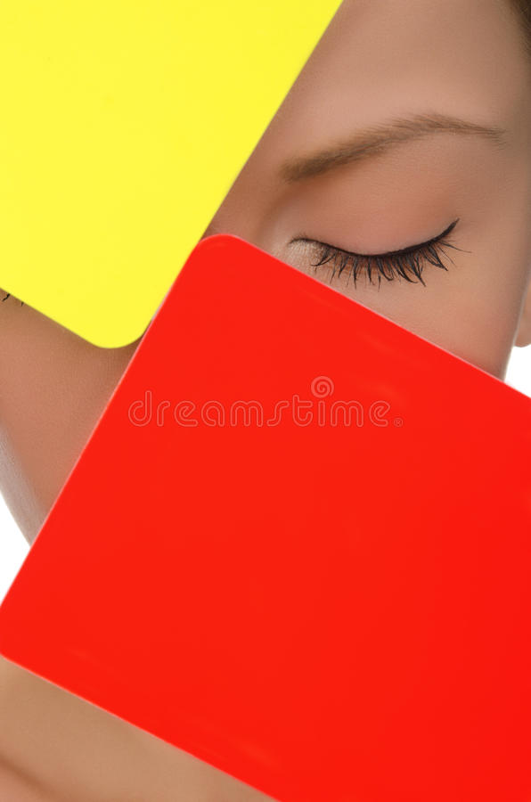Face of young woman with red and yellow soccer card stock images