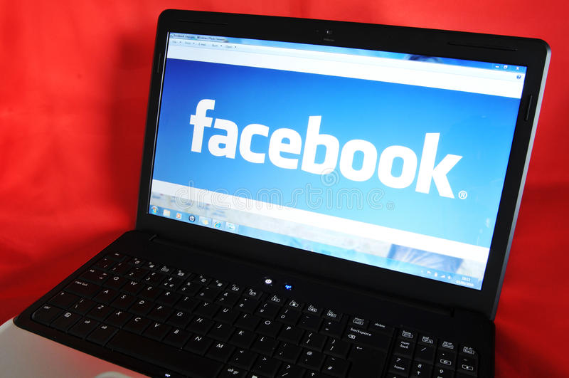 Facebook. Home page on laptop screen