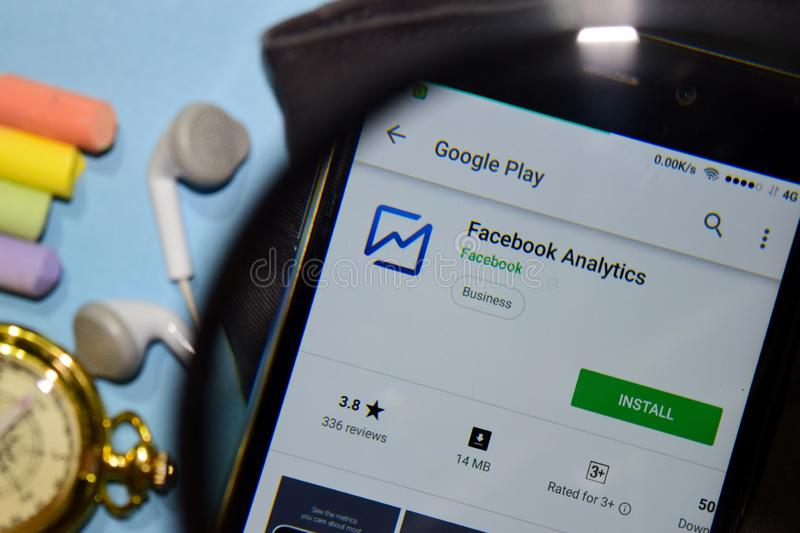 Facebook Analytics dev app with magnifying on Smartphone screen stock photos