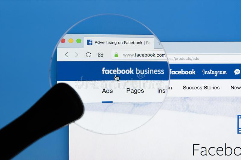 Facebook business homepage website on Apple iMac monitor screen under magnifying glass. Facebook is the most popular social. Sankt-Petersburg Russia December 7 stock photography